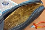 Torba z aluminiowym wnętrzem i skradzione ubrania na blisko 5500 zł